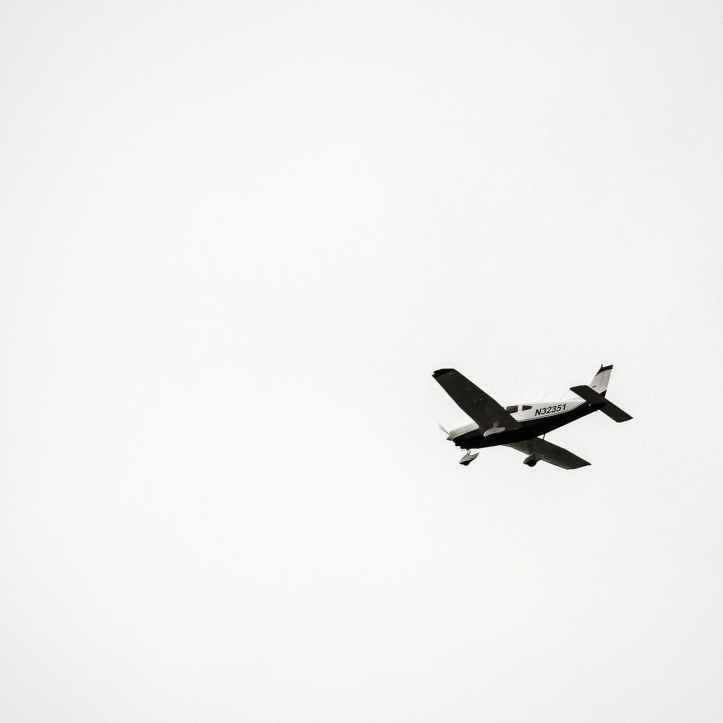black and white airplane in mid air